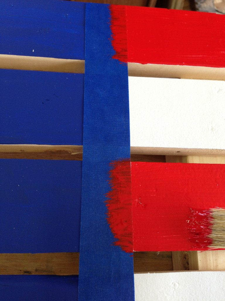 Painting the red stripes on the pallet flag