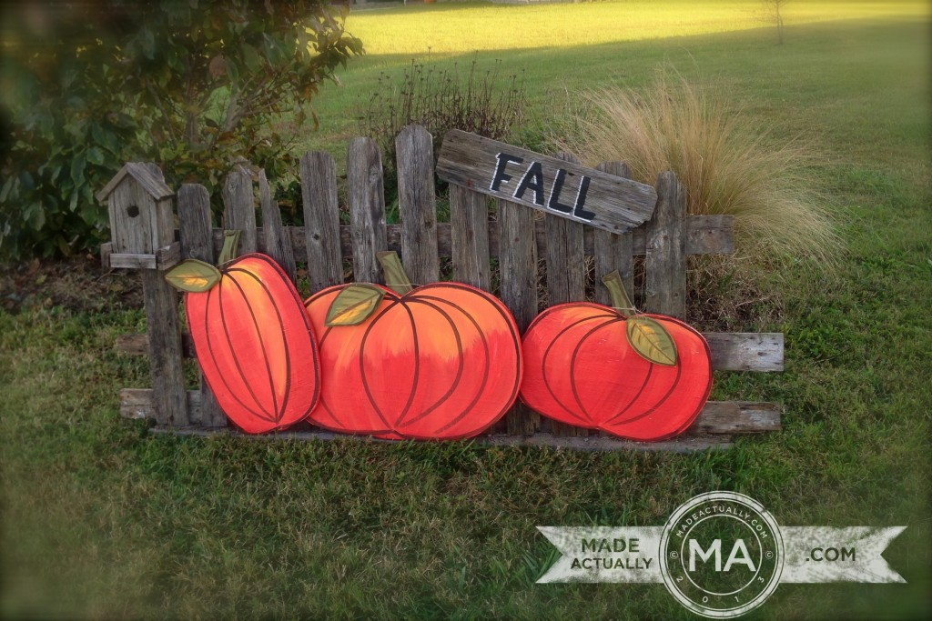 Fall yard art with pumpkins