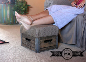 An antique milk crate upcycled into foot stool