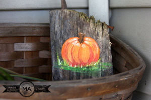 Handpainted pumpkin on a recycled block of wood